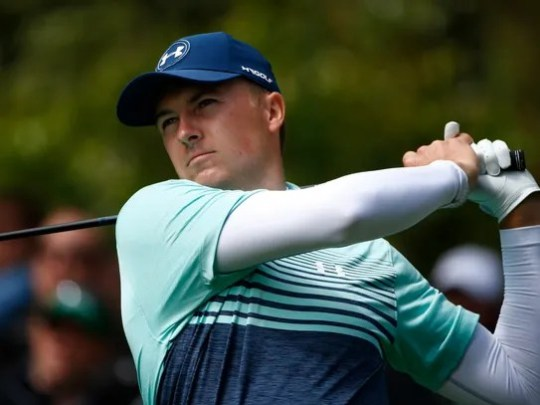 Jordan Spieth hits his tee shot on the 7th hole during