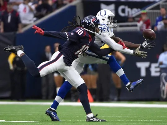 Indianapolis Colts cornerback Pierre Desir (35) breaks up a pbad intended for Houston Texans wide receiver DeAndre Hopkins (10) during the half of an NFL football game Sunday, Nov. 5, 2017, in Houston. (AP Photo/Eric Christian Smith)
