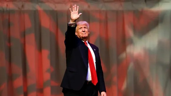 Republican presidential candidate Donald Trump waves