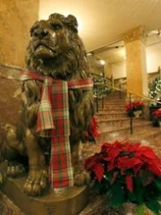 Even the bronze lions in the lobby get a holiday touch