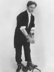 Magician Harry Houdini is shown, before-style, in one