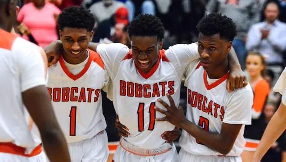 Teammates Brandon Coleman, left, Fred Mulbah, center,