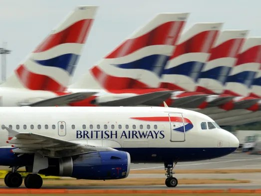 A British Airways aircraft taxis past other BA planes at Terminal 5 of Heathrow Airport in London on July 30, 2010.