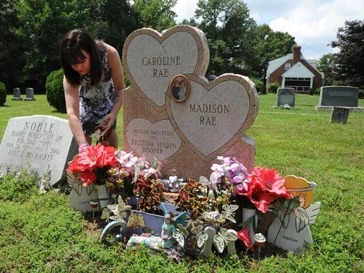 Kristi Hooper visits the grave of her twin daughters