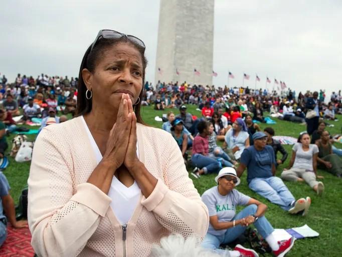 Giselle Shapiro of Los Angeles holds her hands in prayer