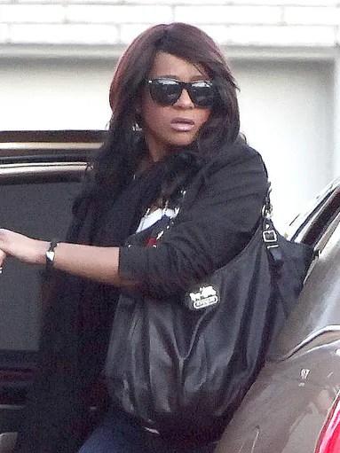 Here, Bobbi Kristina is seen arriving at a Newark,