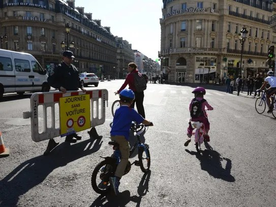 """The sign reads, """"A day without cars,"""" as Parisians"""