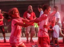Volunteers of the Color Run excitedly spray runners