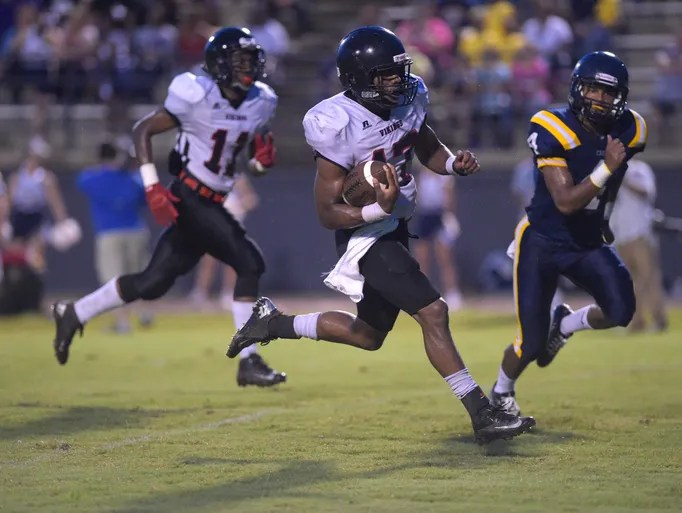 Northside quarterback Ethan Rose Jr. (17) sprints toward the end zone for a touchdown during the first half of an LHSAA football game at Carencro High School in Carencro, La., Friday, Sept. 12, 2014.  Paul Kieu, The Advertiser