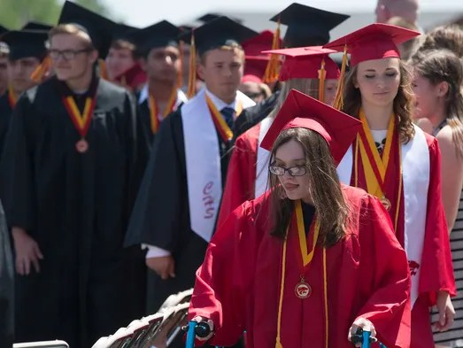 Alexis McCaughey walks in the processional during graduation