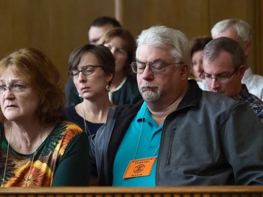 Family members of the mass shooting victims watch as