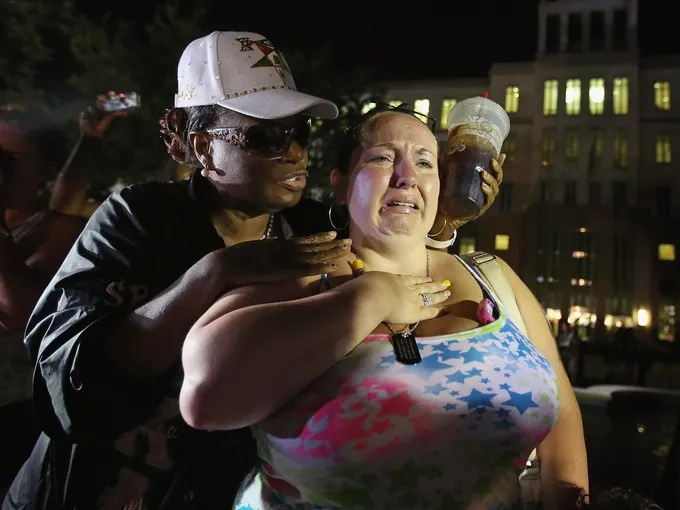 Kat Crowe, left, and Melinda O'Neal comfort each other in front of the Seminole County courthouse after learning George Zimmerman had been found not guilty late July 13 in the Murder of Trayvon Martin.