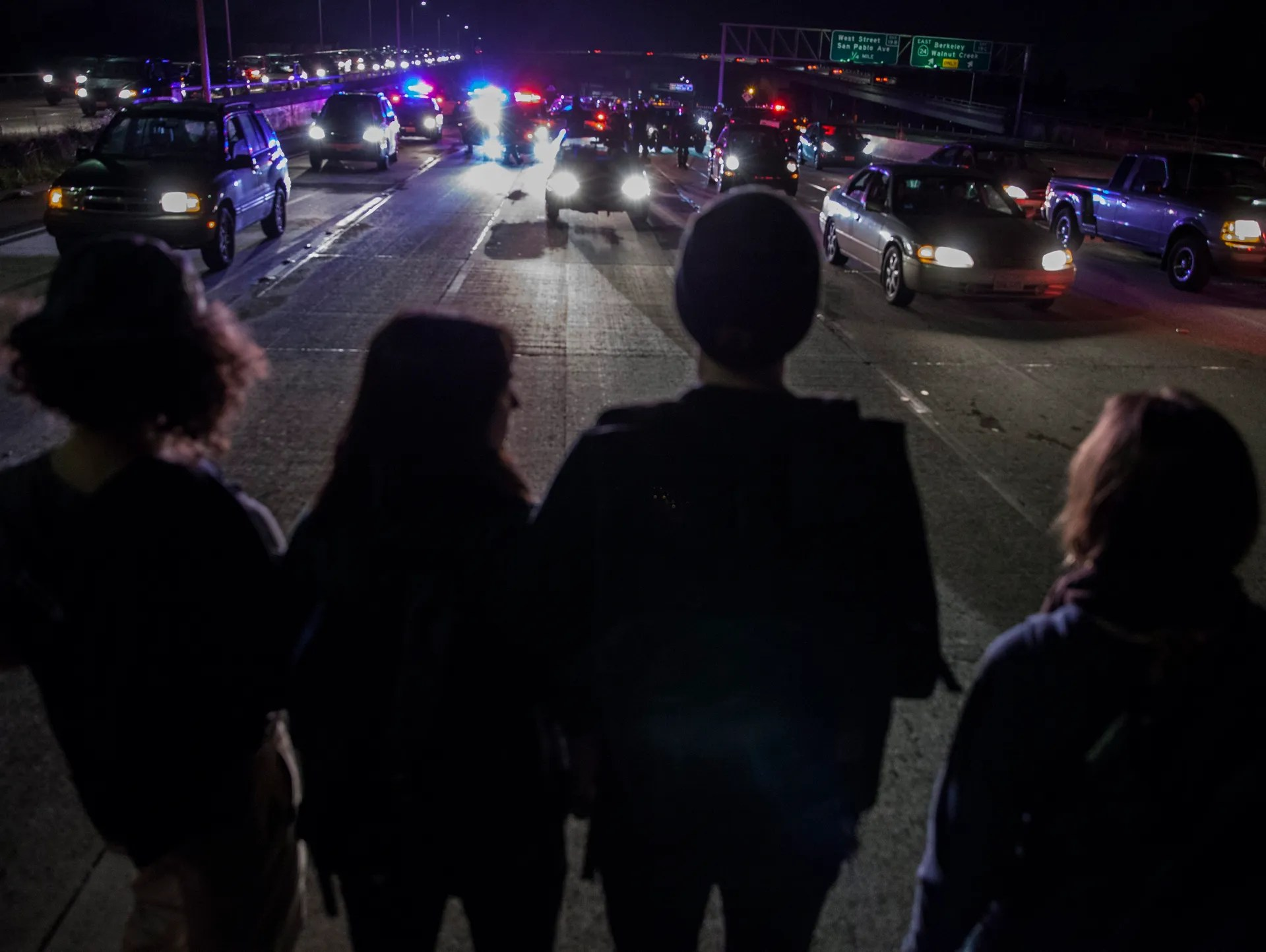 Demonstrators block traffic on the HWY 580 freeway