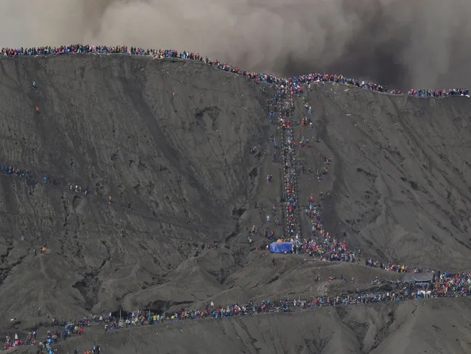 Hindu devotees climb up to the crater of Mount Bromo.