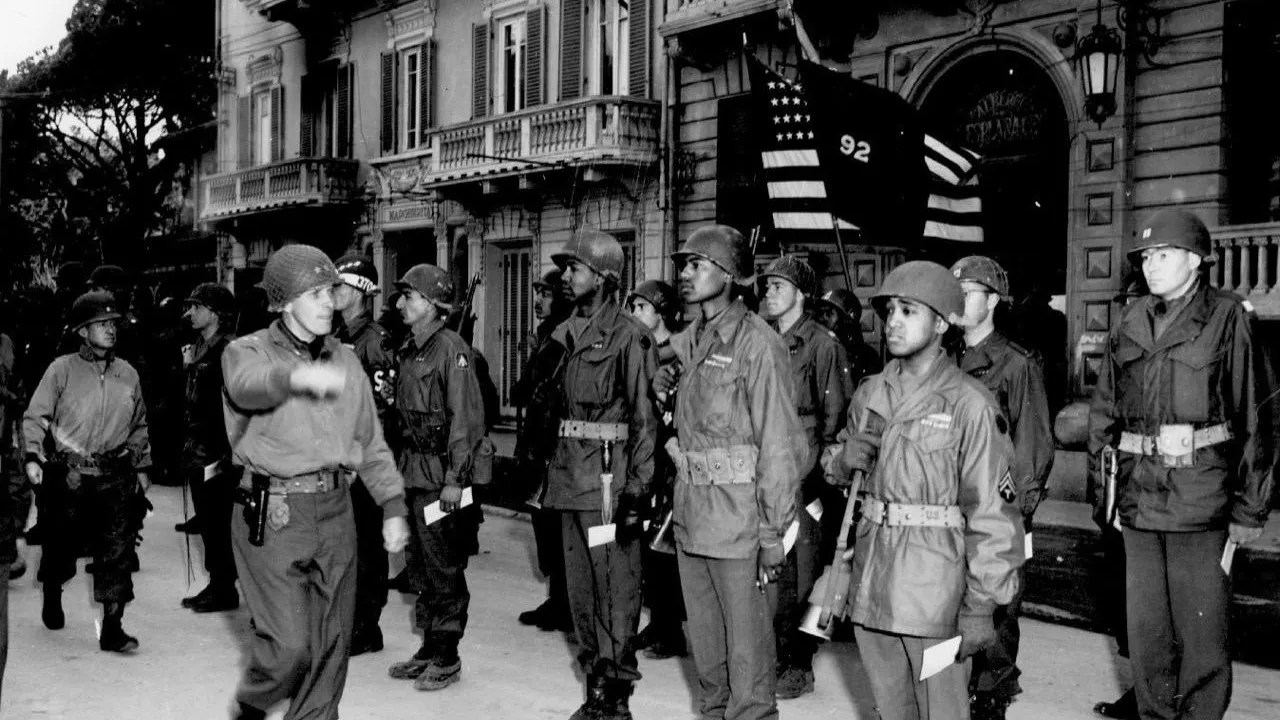 Members of the 366th Infantry Regiment, part of the all-Black Buffalo Soldiers, stands at attention during a campaign in Italy in 1944. Calvin Johnson, the author's brother, served in the regiment.