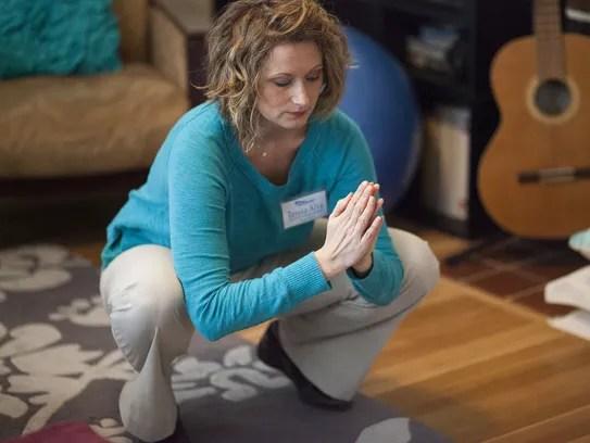 Instructor Teresa Alva demonstrates an exercise during