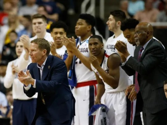 Gonzaga coach Mark Few claps with his team and coaching
