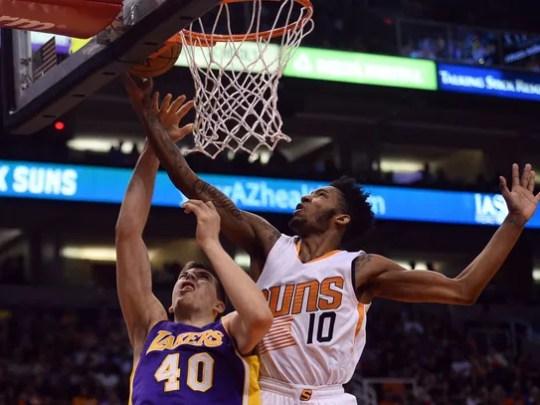 Derrick Jones Jr. blocks a layup attempt by Lakers