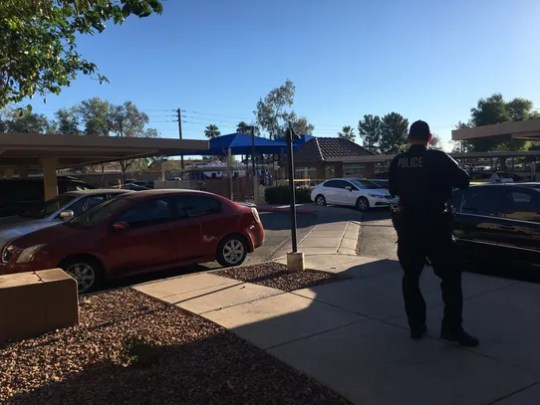 The apartment-complex parking lot in Tempe where two