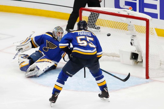 Blues goaltender Jordan Binnington and defenseman Colton Parayko watch as a shot from San Jose Sharks defenseman Erik Karlsson (not pictured) goes in the net for the game-winning goal during overtime in Game 3 of the Western Conference final.
