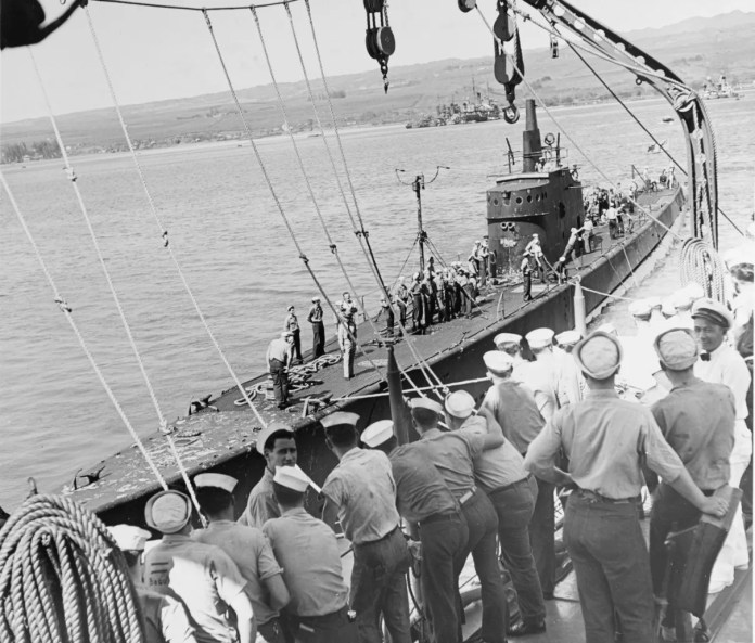 The USS Trout approaches the USS Detroit at Pearl Harbor in early March 1942 to unload a cargo of gold it evacuated from the Philippines.