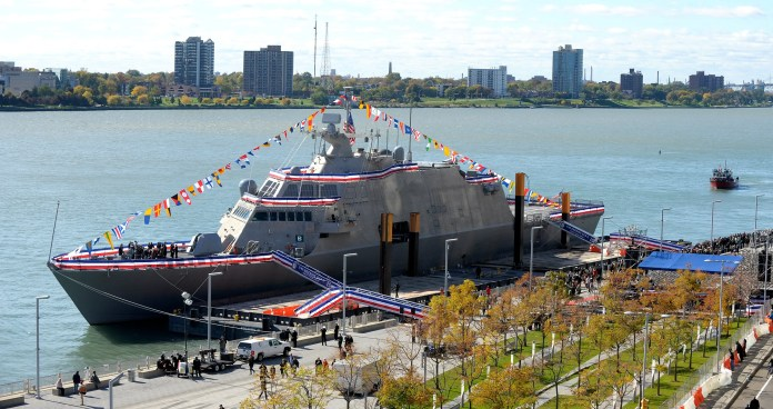 Ceremony attendees prepare to tour the USS Detroit on its commissioning day.