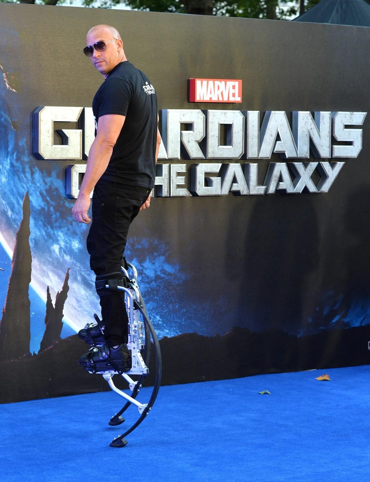 """Vin Diesel gets a lift at the UK premiere of """"Guardians of the Galaxy"""" in 2014."""