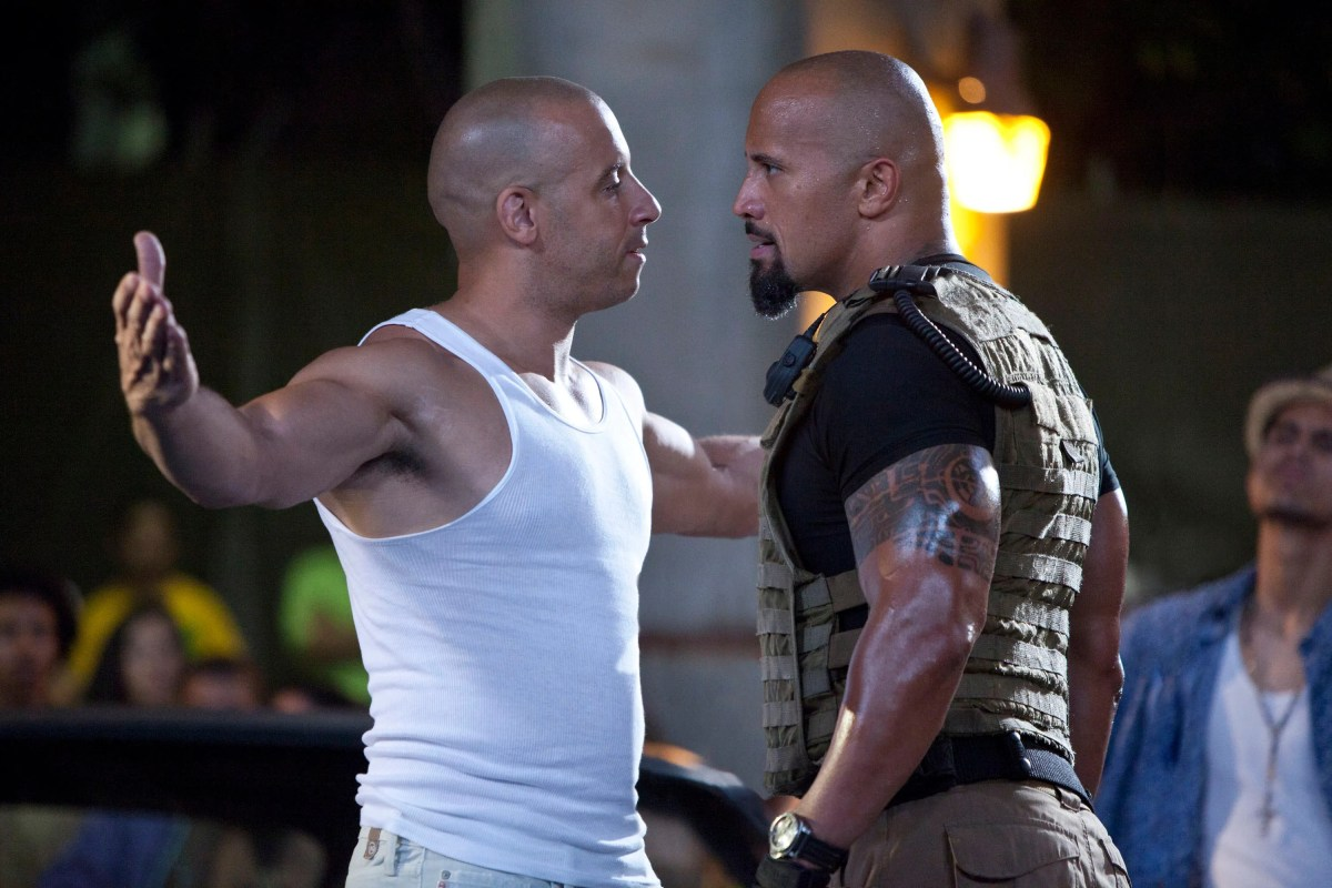 """Beef back then? Vin Diesel and Dwayne Johnson are shown in a scene from """"Fast Five."""" Ironically, it's rumored that there was real tension between the two stars on set in """"The Fate of the Furious"""" in 2017!"""