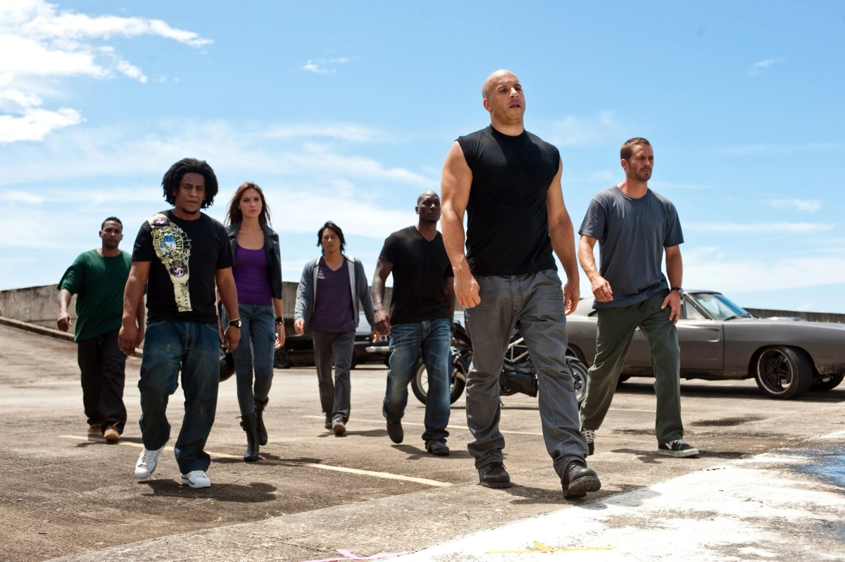 """Don Omar, Tego Calderon, Gal Gadot, Sung Kang, Tyrese Gibson, Vin Diesel, and Paul Walker in a scene from the 2011 thriller """"Fast Five."""""""