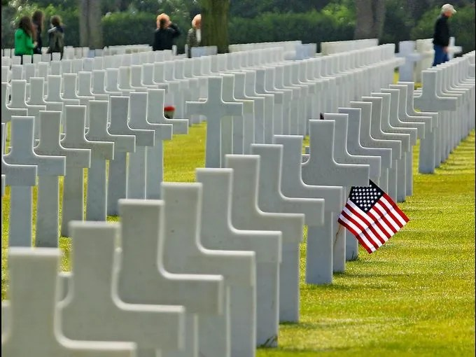 Visitors walk among the 9,387 graves at the Colleville American Military Cemetery on the 69th anniversary of the 1944 D-Day invasion on June 6 in Colleville sur Mer, France. Several hundred veterans of the 1944 D-Day landings in Normandy gathered to commemorate the invasion of Nazi-occupied Europe during World War II.