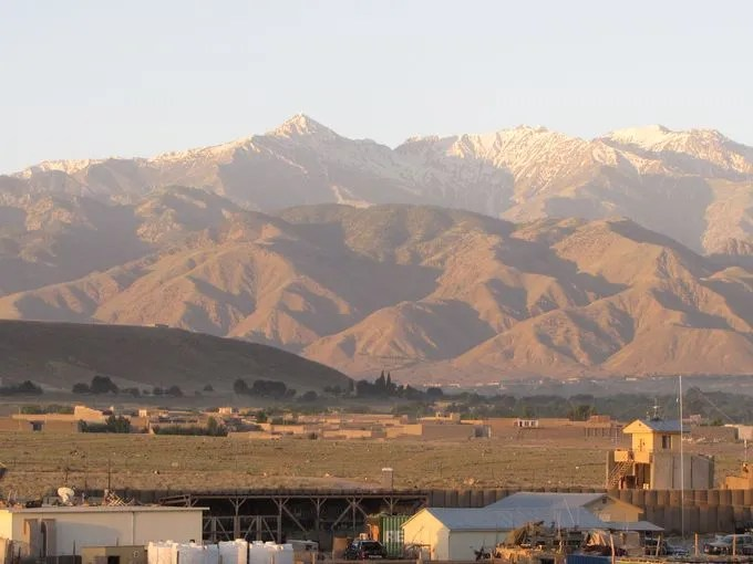 The sun rises over the Tora Bora mountains in Khogyani district. In the foreground is Forward Operating Base Connolly. Caves in Tora Bora provided a hiding place for Osama bin Laden shortly after the U.S. invasion in October 2001.