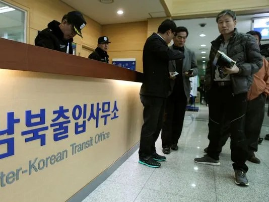 South Koreans wait to leave for the North Korean city of Kaesong at the Inter-Korea Transit Office in Paju, South Korea, on Monday