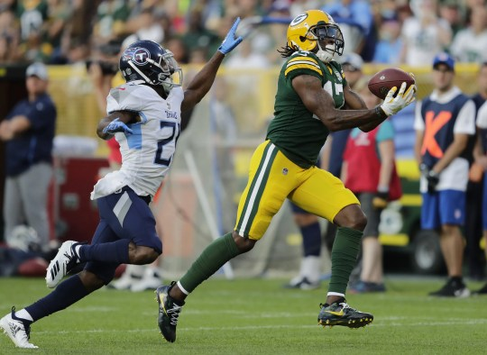 Green Bay Packers wide receiver Davante Adams (17) pulls down a 48-yard reception against Tennessee Titans defensive back Malcolm Butler in the first quarter during their football game Thursday, August 9, 2018, at Lambeau Field in Green Bay, Wis.