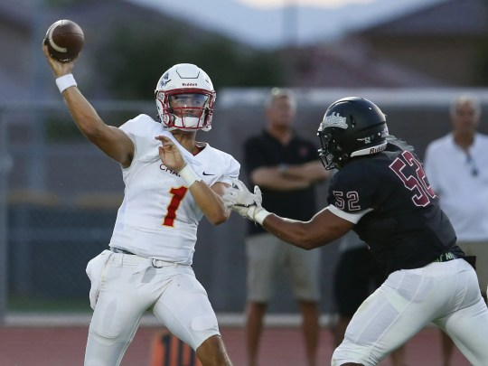 Chaparral quarterback Jack Miller (1) attempts to pass the ball before being tackled by  Hamilton Derrick Porter (52) during a high school football game at Hamilton in Chandler on August 17, 2018. #hsfb