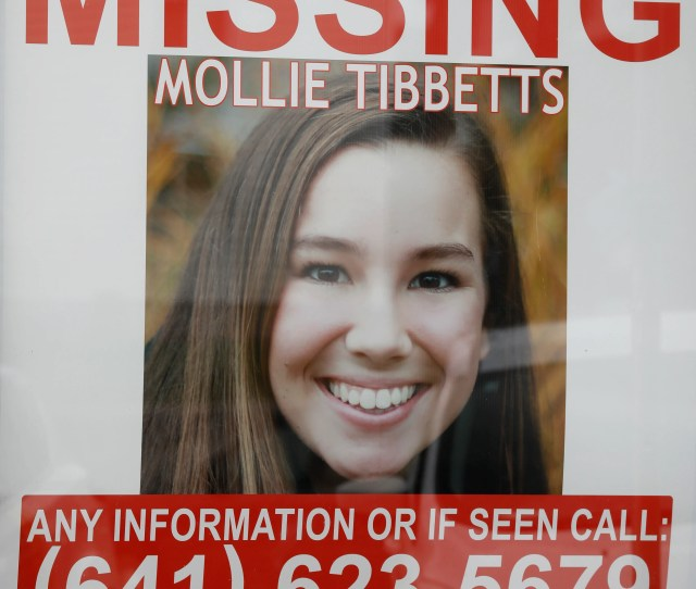 A Poster For Missing University Of Iowa Student Mollie Tibbetts Hangs In The Window Of A Local Business Tuesday Aug   In Brooklyn Iowa