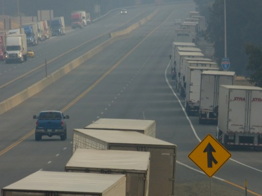 Trucks parked off northbound Interstate 5 were backed up Thursday morning, Sept. 6, 2018, to nearly the Shasta Dam Boulevard exit.
