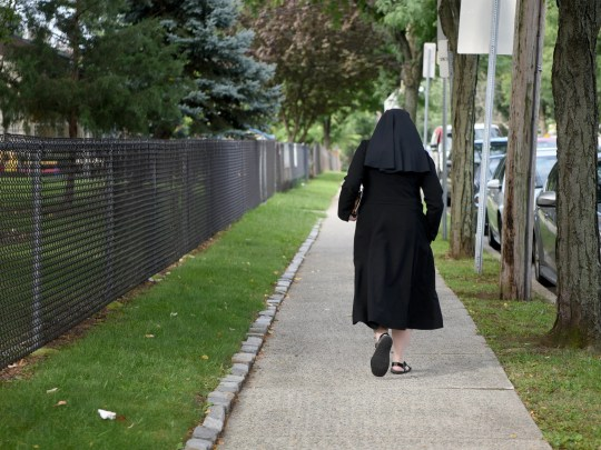 A nun leaves Sacred Heart Church in Clifton after the Latin Mass on 2 September.