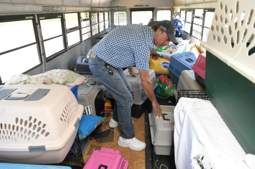Animal crates fill East Tennessee resident and truck driver Tony Alsup's school bus that he purchased to rescue shelter animal. On Monday he drove the bus to South Carolina to pick up dogs and cats from shelters in the path Hurricane Florence.  Alsup transported 64 dogs and cats to Alabama and plans to go back.