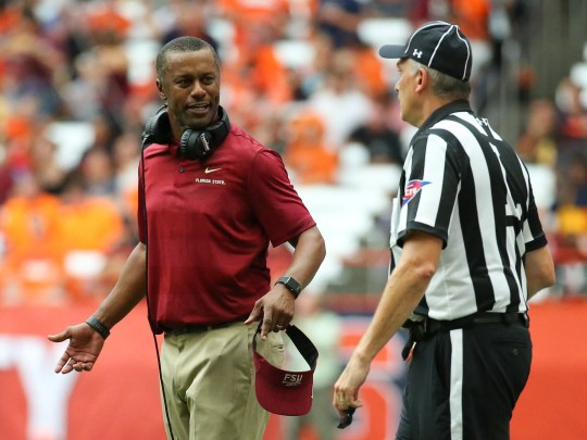 Florida State Coach Willie Taggart responds to a phone call against Syracuse in the second quarter in the Carrier Dome.