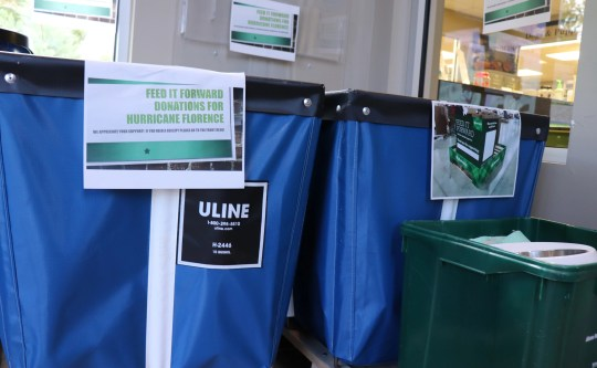 Multiple bins stand in the lobby of the Humane Society of the Tennessee Valley for Hurricane Florence donations.