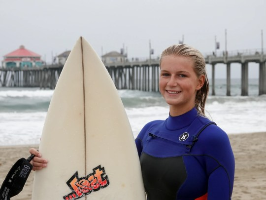 Local surfer Summer Balentine poses for a photo after stepping out of the water.