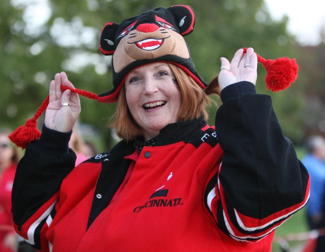 Cathy Barnes of White Oak shows her school spirit during University of Cincinnati Homecoming parade on October 14, 2011.