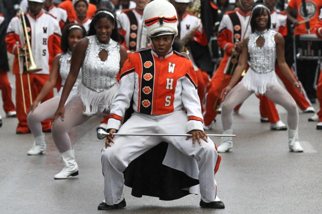 The Withrow High School Marching Tigers participate in the annual University of Cincinnati homecoming parade, marching down Clifton Avenue on October 19, 2013.