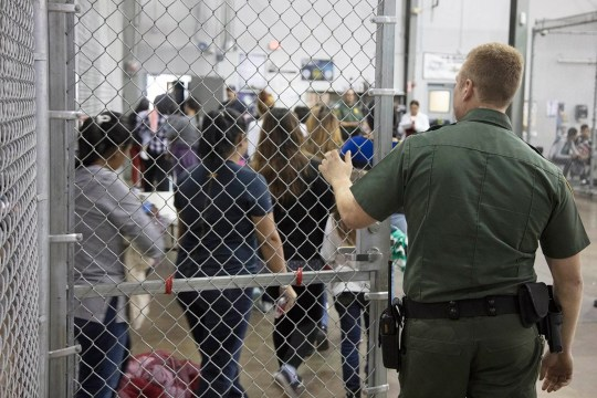 An undated handout photo made available on 18 June 2018 by the US Customs and Border Patrol showing people inside a United States Border Patrol Processing Center, in McAllen, Texas.