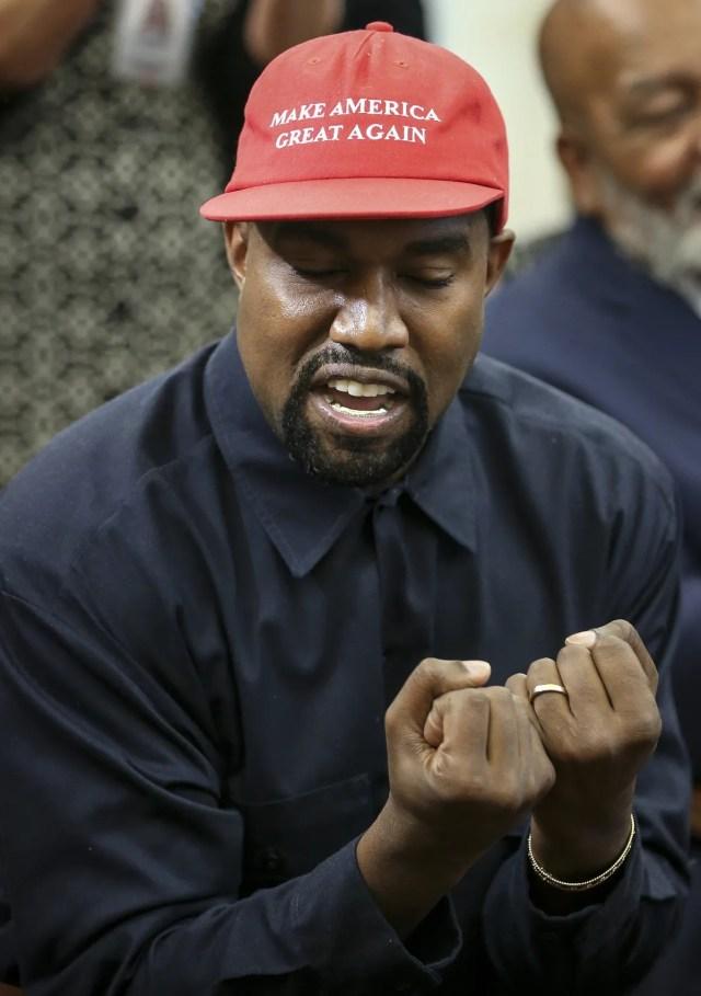 West gestures.