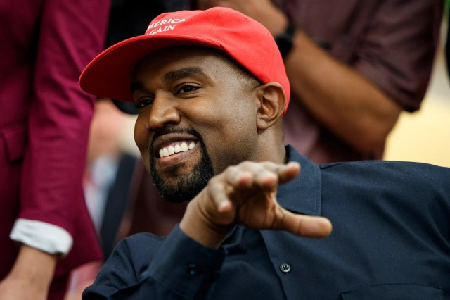 Rapper Kanye West smiles as he talks with  Trump during their meeting.