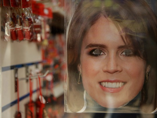 A Princess Eugenie mask is displayed for sale in the window of a souvenir shop in Windsor, Oct. 10, 2018.
