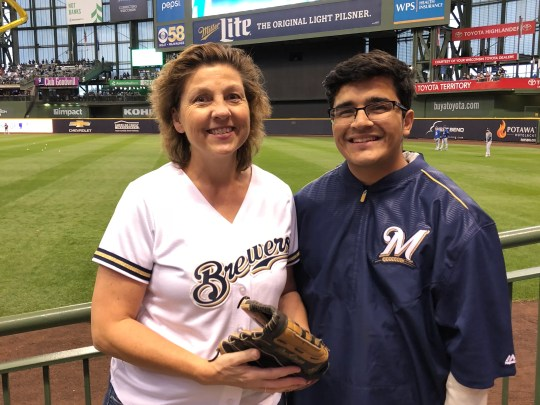 Cindy Rogers is ready to catch a flying ball at the first NLCS race of the Brewers against the Los Angeles Dodgers on October 12, 2018. Her son Matthew Rogers (right) has a back-up.