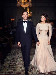 In this photo on Saturday, October 13, 2018 from Buckingham Palace, Britain's Princess Eugenie of York and Jack Brooksbank are photographed at the Royal Lodge, Windsor, England, before the private dinner, after their wedding, in St. George's Chapel, Windsor Castle on Friday, October 12, 2018.