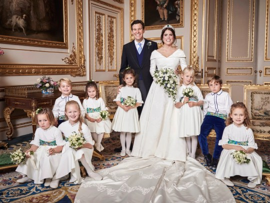 This photo taken on Saturday, October 13, 2018 by Buckingham Palace, Britain's Princess Eugenie of York and Jack Brooksbank are photographed in the White Drawing Room, by Windsor Castle, with Phillips, from left, back row, Prince George, Princess Charlotte, Theodora Williams, Isla Louis De Givenchy. First row, Mia Tindall Savannah Phillips and Maud Windsor, after their wedding, at St. George's Chapel, Windsor Castle on Friday, October 12, 2018.